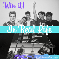 Win an In Real Life Autographed Tour Poster with VIP Lanyard + Keychain!