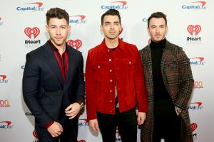 NEW YORK, NEW YORK - DECEMBER 13: Nick Jonas, Joe Jonas, and Kevin Jonas arrive at iHeartRadio's Z100 Jingle Ball 2019 at Madison Square Garden on December 13, 2019 in New York City. (Photo by Monica Schipper/Getty Images)