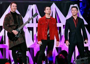 NEW YORK, NEW YORK - DECEMBER 13: Kevin Jonas, Joe Jonas, and Nick Jonas perform onstage during iHeartRadio's Z100 Jingle Ball 2019 at Madison Square Garden on December 13, 2019 in New York City. (Photo by Dia Dipasupil/Getty Images for iHeartMedia )